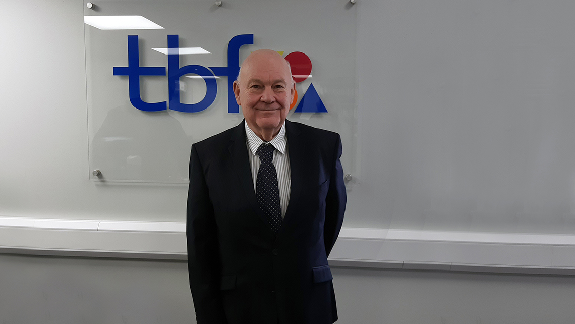 Pete Ryland in front of tbf logo